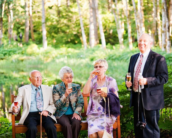 Elderly guests drink champagne  - Bridal Veil Lakes wedding - Portland Oregon