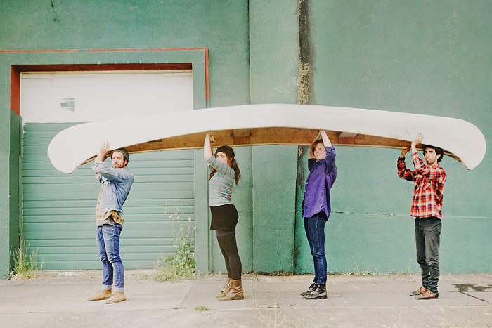 Portland folk band Gallop with their canoe