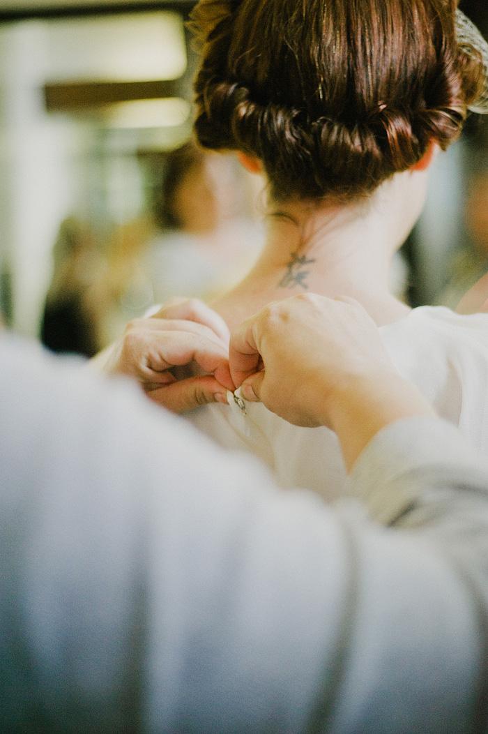 Oaks Pioneer Church Wedding Photographer - Bride Getting into Dress