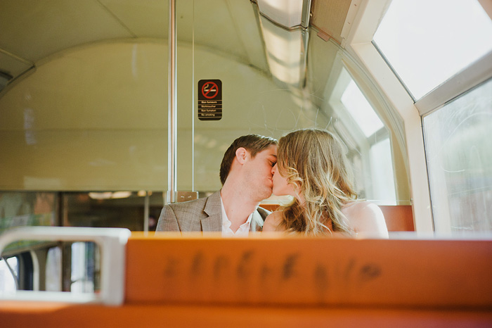 Portland Portrait Photographer - Bride and Groom kissing on the Metro
