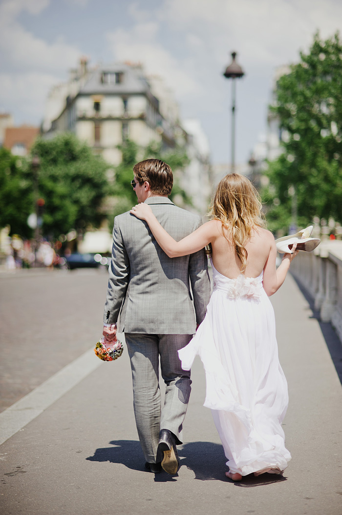 Paris elopement photographer - Newlyweds walking across bridge
