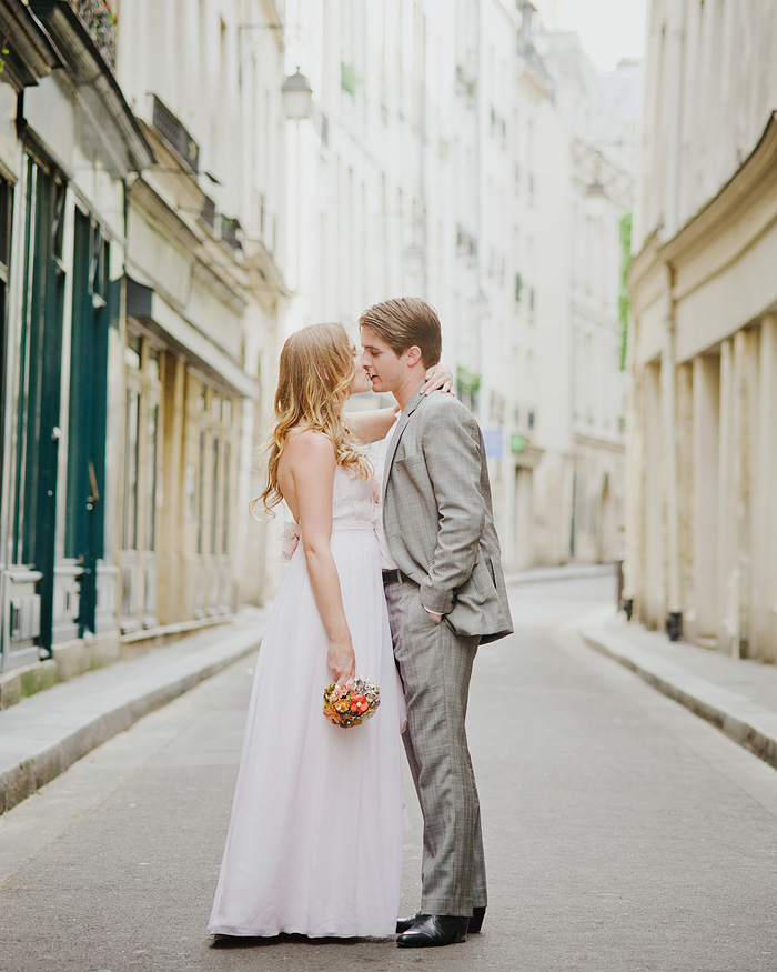 Paris wedding photographer - Newlyweds kissing in Paris alley