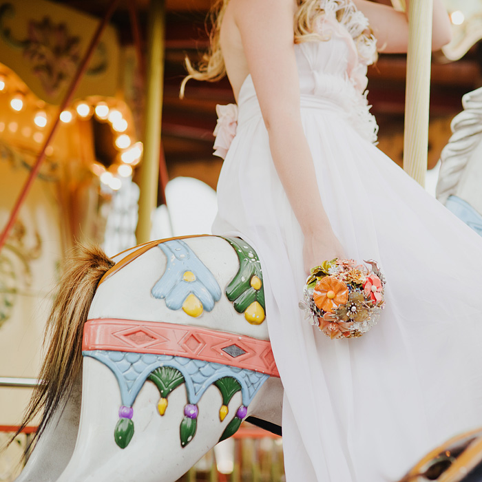 Bride on Carousel - Paris wedding photographer