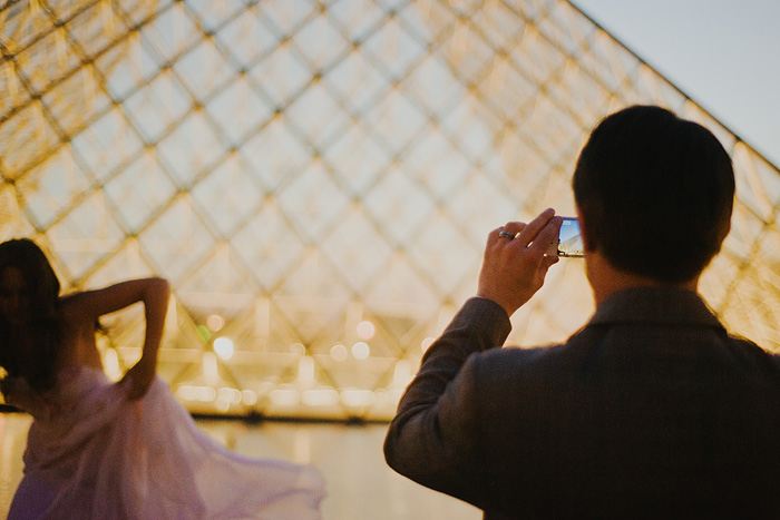 Groom taking photo on iPhone - Louvre - Paris, France