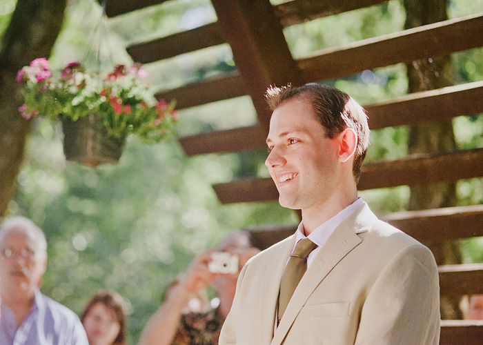 Groom smiling at Camp Royaneh wedding ceremony
