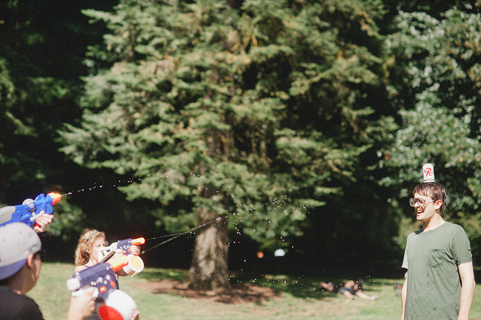 Portland Lifestyle Photographer - Water Gun Fight in Laurelhurst Park