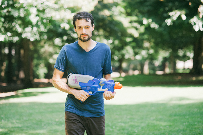 Portland Portrait Photographer - Water Gun Fight in Laurelhurst Park
