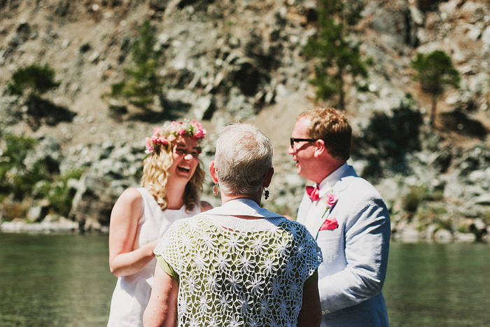 Bride giggling while exchanging vows - Smith River wedding - Gasquet, CA