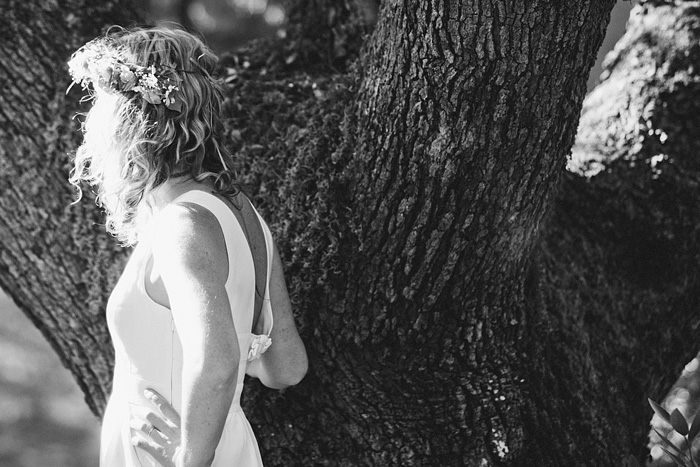 Bride leaning on an oak tree - Smith River Wedding - Gasquet, CA