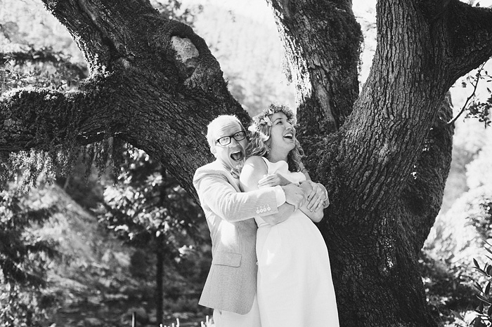 Groom surprising bride with a hug - Smith River wedding - Gasquet, CA