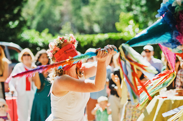 Crescent City Wedding Photographer - Blindfolded bride attacking the wedding pinata in Gasquet, CA
