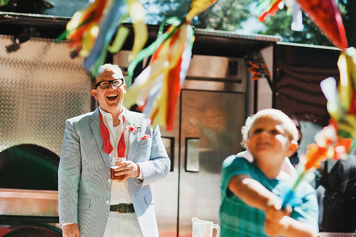 Crescent City Wedding Photographer - Groom laughing at little boy hitting a pinata in Gasquet, CA