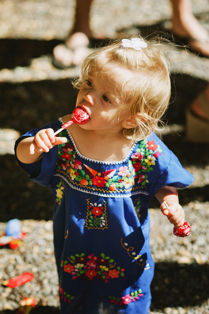 Toddler eating suckers with the wrapper on - Intimate Backyard Wedding - Gasquet, CA