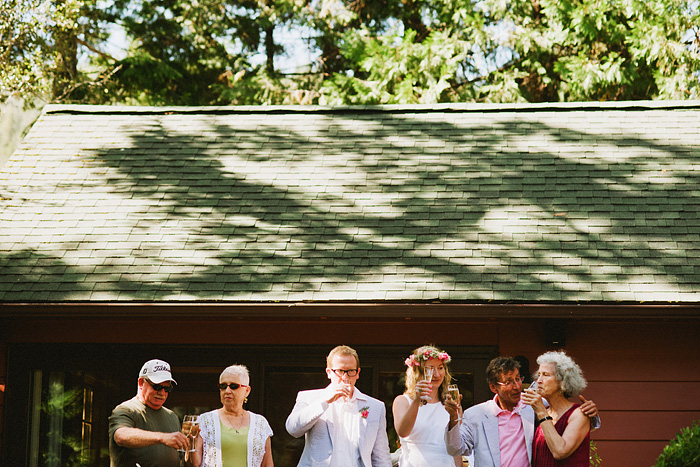 Crescent City Wedding Photographer - Bride and Groom give champagne toast with parents in Gasquet, CA