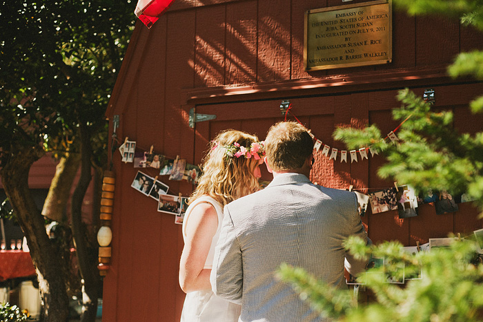 Bride and groom looking at their red barn wedding photo montage - Intimate Backyard Wedding - Gasquet, CA