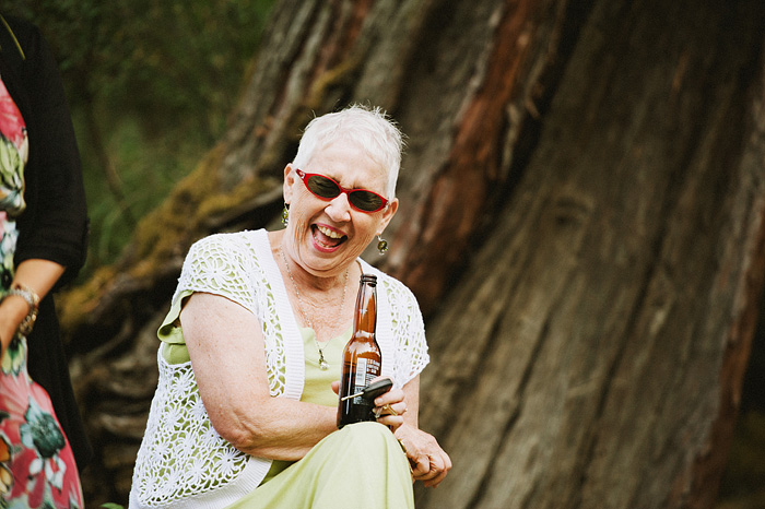 Mother of Groom laughing while drinking a beer - Intimate Backyard Wedding - Gasquet, CA
