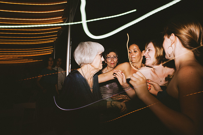 Portland Oregon Wedding Photographer - Guests singing to the bride's grandma - World Forestry Center Reception