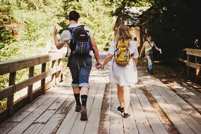 Salem Wedding Photographer - Bride and Groom hiking to ceremony - Opal Creek Wilderness