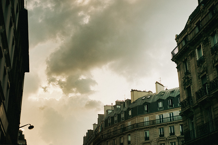Paris wedding photographer - Clouds and typical Parisian buildings off Rue Saint-Denis