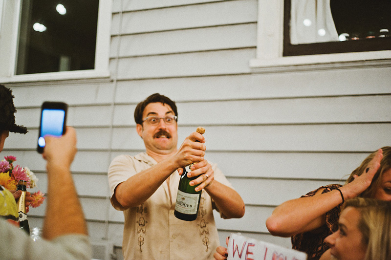 Multnomah Courthouse Wedding Photographer - Groom Popping the Champagne - Backyard Reception