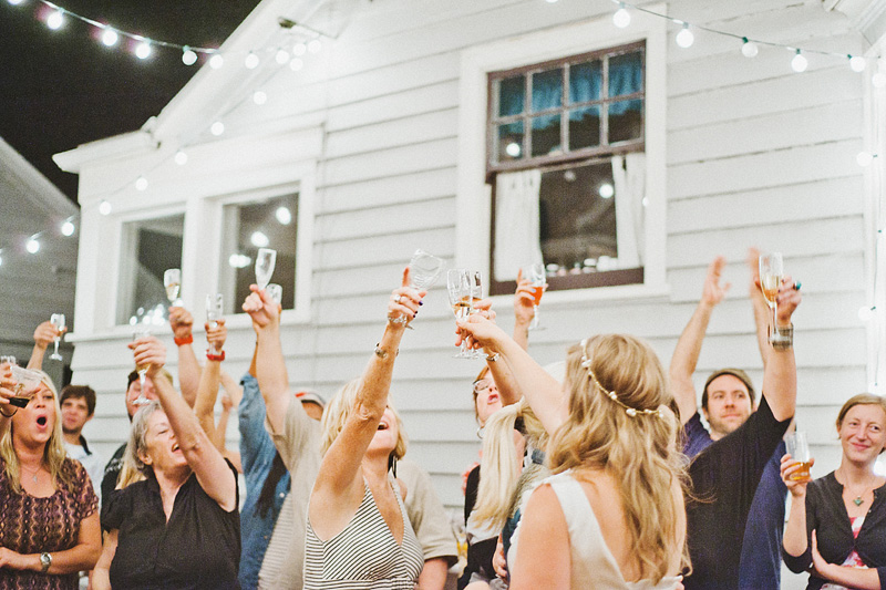 Multnomah Courthouse Wedding Photographer - Guests raise a glass at the midnight champagne toast