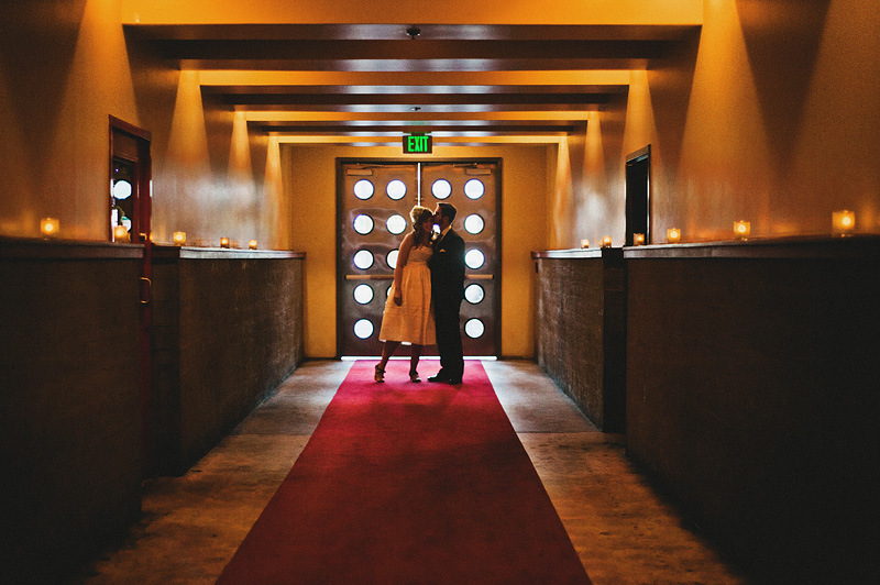 San Francisco Wedding Photographer - Couple kissing in Foreign Cinema hallway