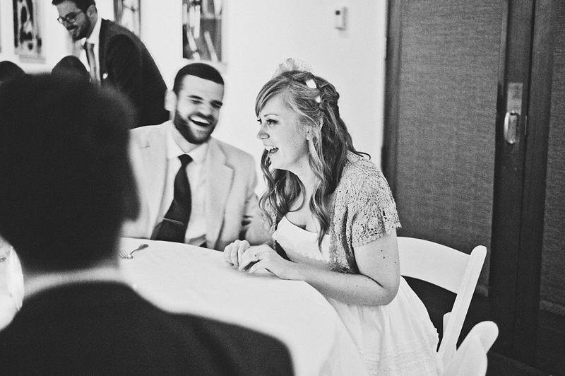 Documentary San Francisco Wedding Photographer - Bride laughing with guests - Reception at Foreign Cinema