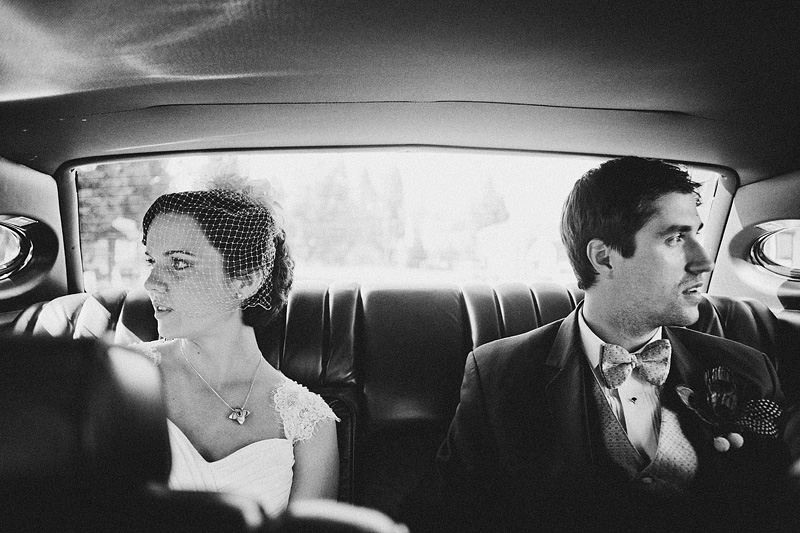 Oregon Wedding Photographers - Bride and Groom riding in car