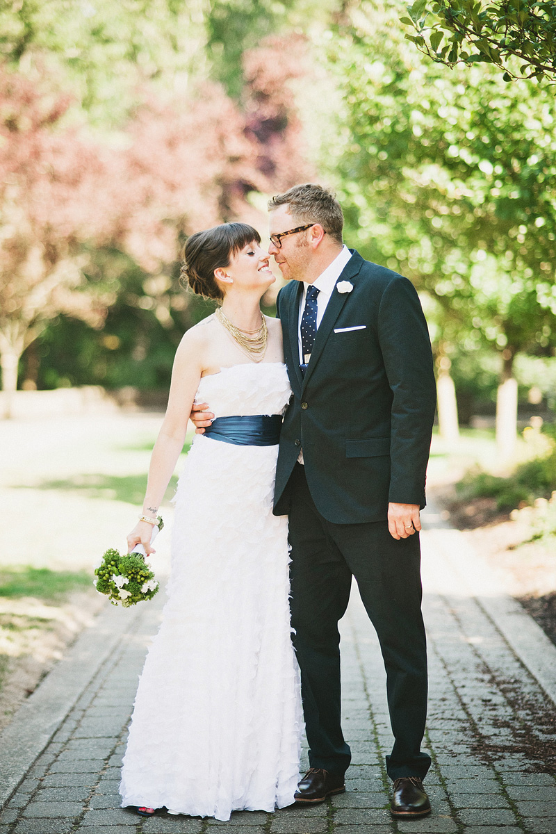 Oregon Wedding Photographers - Newlyweds kissing at the World Forestry Center