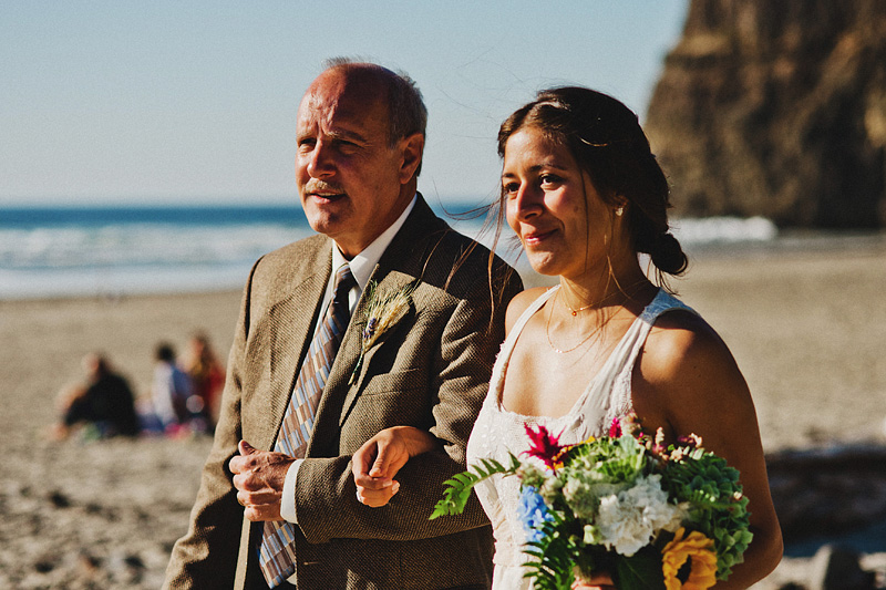 Bride walking down the aisle with her father - Oceanside beach ceremony