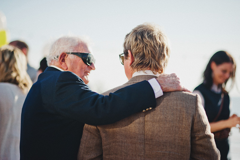 Oceanside Wedding Photographer - Groom talking with Grandpa - Oceanside Community Center Reception