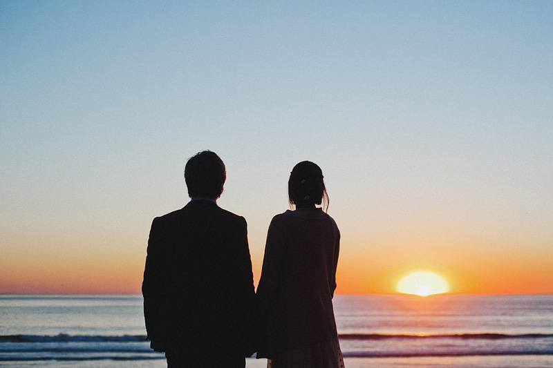 Netarts Wedding Photographer - Bride and Groom watching the sun set over the ocean