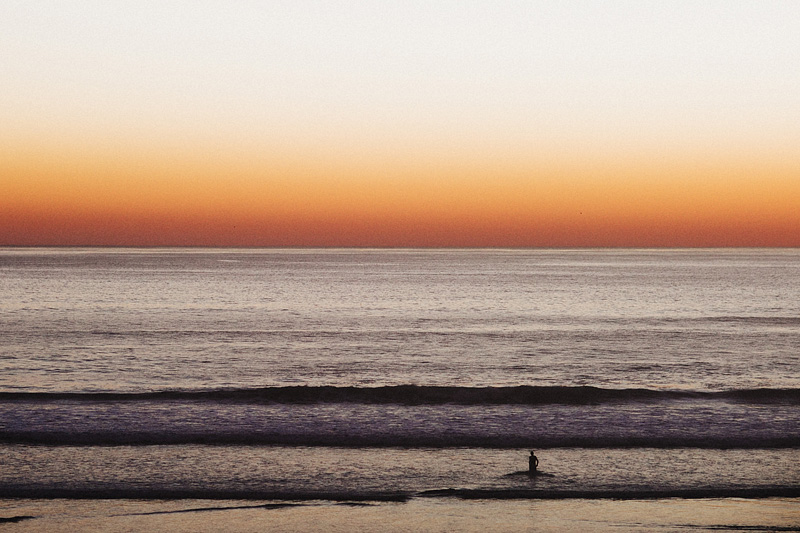 Tillamook Wedding Photographer - Man standing in the ocean at sunset - Oceanside, OR