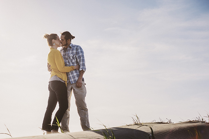 Humboldt Portrait Photographer - Rowan and Dustin kissing on a sand dune at Mad River Beach, CA