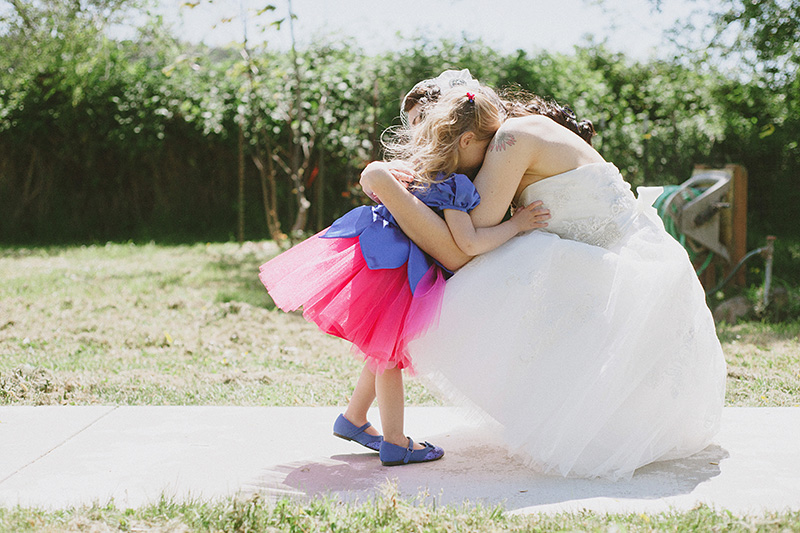Arcata Wedding Photographer - Bride and flower girl hugging