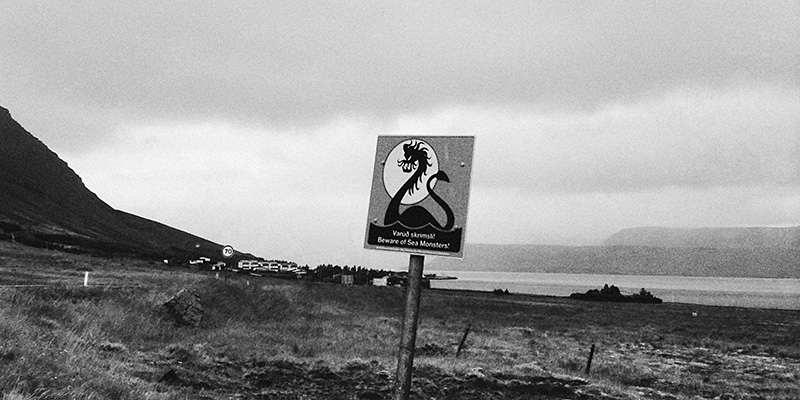 Iceland Wedding Photographer - Sign reading Beware of Sea Monsters!