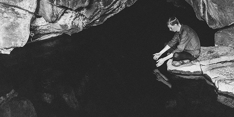 Iceland Wedding Photographer - Chris sitting inside the geothermal cave Grjótagjá