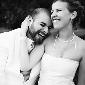 Danny and Lindy laughing in the grass - Bay Area Wedding Photographer