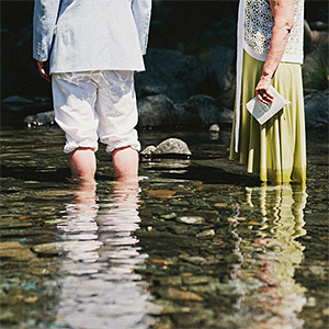 J.R. and his mother standing in the Smith River - Crescent City Wedding Photographer
