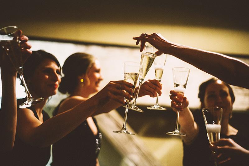 Bridesmaids toasting in the bridal loft - Sodo Park Wedding Photographer