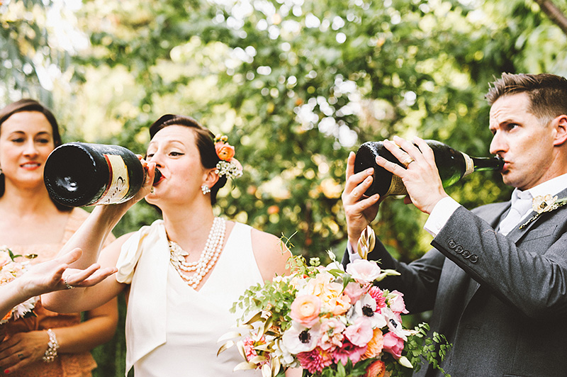 Bride and Groom chugging champagne at their Secret Society Wedding