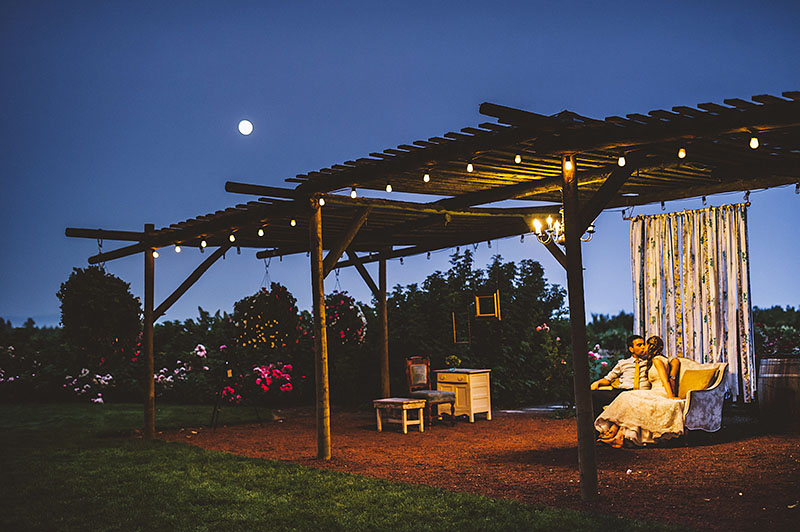 Bride and Groom sharing a kiss under the full moon - Rustic Postlewait's Wedding in Canby, OR