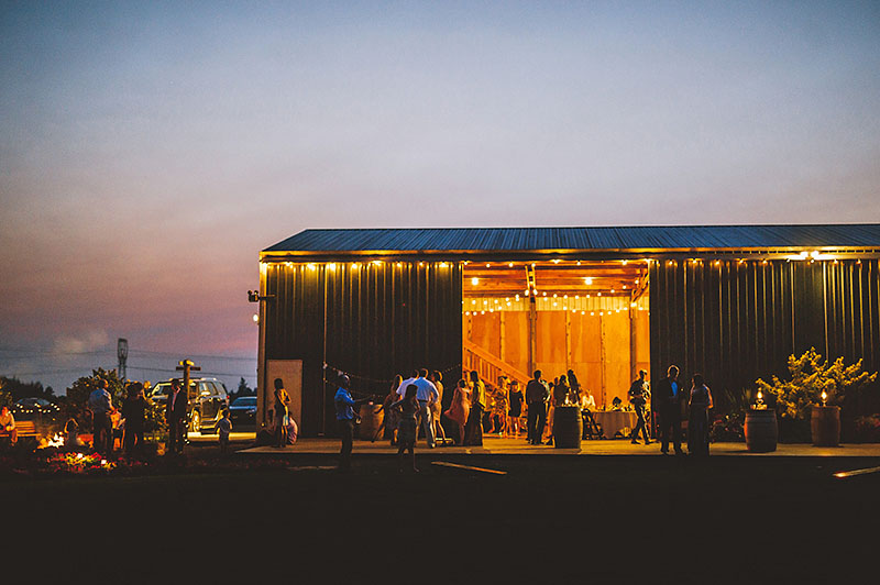 Exterior shot of the venue at night time - Rustic Postlewait's Wedding in Canby, OR