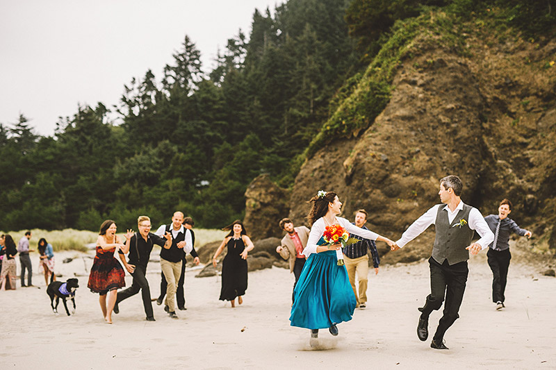 Bride and Groom running from zombie guests