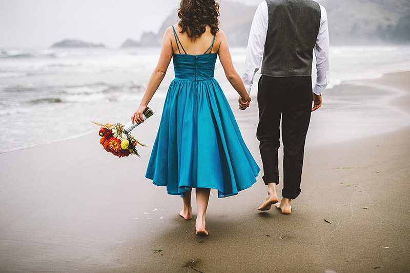 Walking on the beach at their Camp Westwind wedding