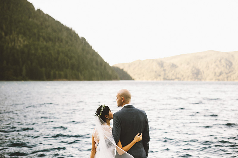 Bride and Groom on the docks of Lake Crescent at a Nature Bridge Wedding