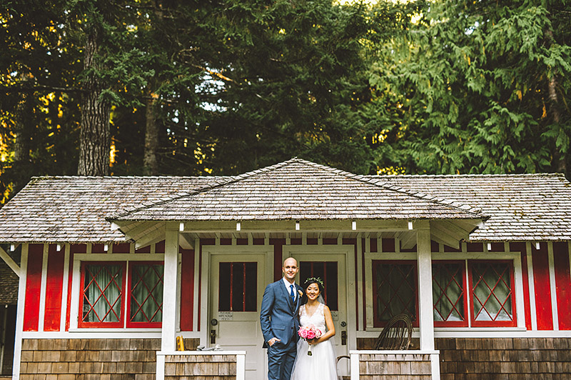 Bride and Groom in front of cabins at a Nature Bridge Wedding