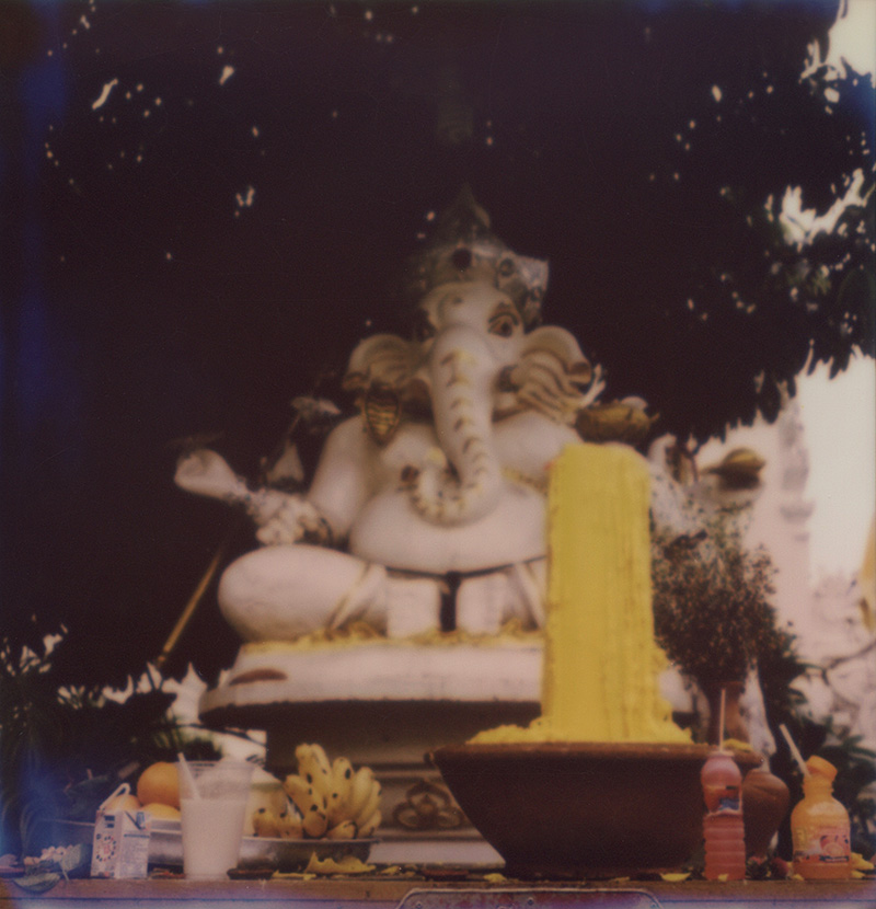 Offerings in front of a Ganesh statue in Thailand | SLR680 Polaroid