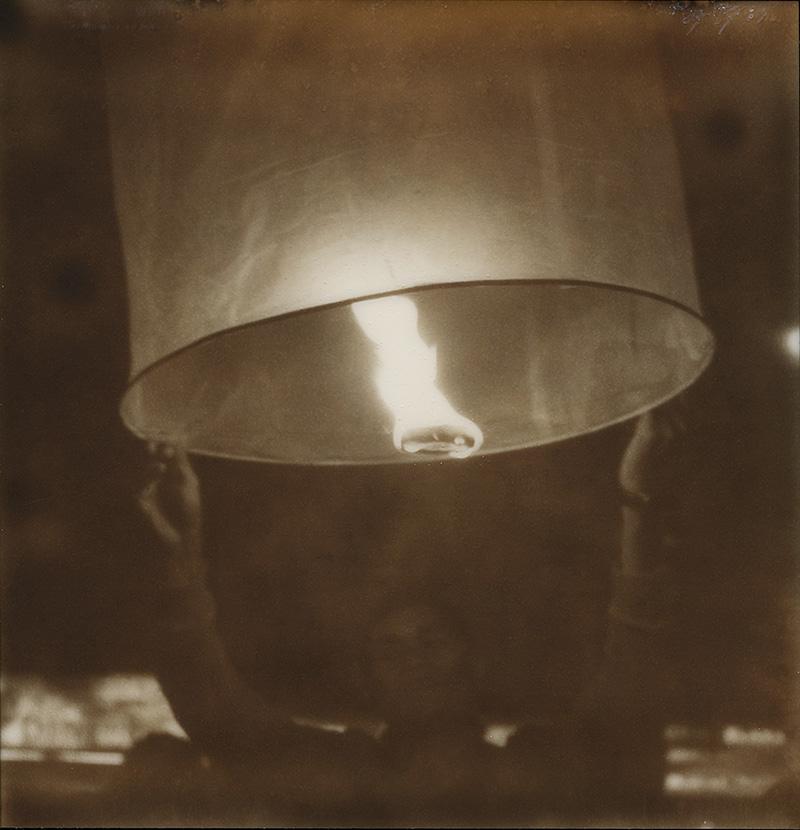Sending off a wish lantern for Loi Krathong | SLR680 Polaroid