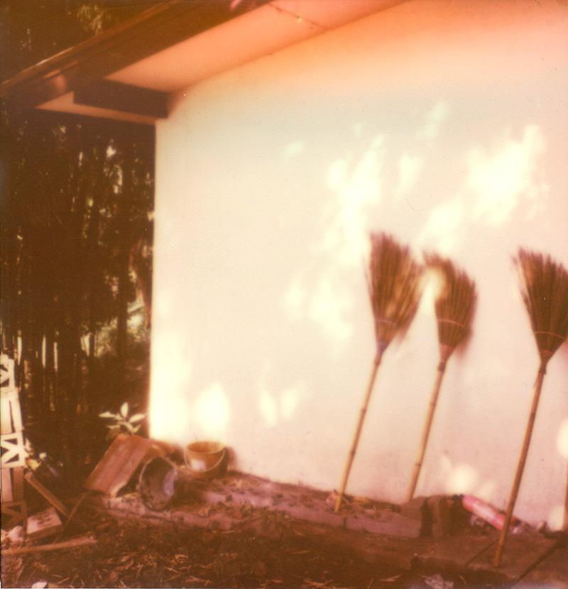 Three brooms at a temple in Thailand   SLR680 Polaroid